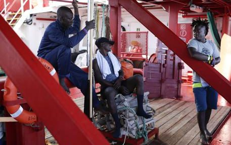Migrants talk to each other aboard the Ocean Viking in the Mediterranean Sea, Saturday, Sept. 14, 2019. The rescue boat with 82 migrants aboard says it has been given permission to dock at the tiny Sicilian island of Lampedusa, southern Italy. (ANSA/AP Photo/Renata Brito) [CopyrightNotice: Copyright 2019 The Associated Press. All rights reserved]