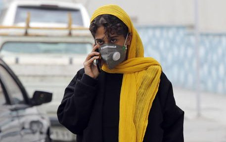 epa08244144 An Iranian woman wearing face mask walks on a street of Tehran, Iran, 24 February 2020. According to the Ministry of Health, 61 people diagnosed with coronavirus in the country and twelve people have died in Iran. The disease caused by the virus (SARS-CoV-2) has been officially named COVID-19 by the World Health Organization (WHO).  EPA/ABEDIN TAHERKENAREH