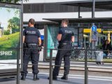 German police officers stand on a platform at a tram station in Kehl, on June 15, 2020, on the reopening day of the borders between France and Germany, closed as part of measures taken to stop the spread of the COVID-19 pandemic caused by the novel coronavirus. (Photo by PATRICK HERTZOG / AFP)
