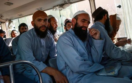 epa08445524 Afghan Taliban prisoners sit inside a vehicle during their release from Bagram prison in Parwan province, Afghanistan, 26 May 2020. The Afghan government released hundreds of Taliban prisoners after the Afghani president announced that his government would free some 900 more Taliban prisoners, report state. A total of 5,000 Taliban prisoners will be released by the Afghan government in exchange for 1,000 Afghan security force members freed by the Taliban as part of a US-Taliban agreement, signed in Doha in February 2020, before intra-Afghan talks between Kabul and the Taliban are set to take place. So far the Afghan government has released 1,000 of the 5,000 Taliban inmates, and the Taliban released a few hundred of the 1,000 Afghan security forces personnel in the prisoner swap process.  EPA/STR
