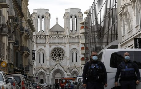 epa08782707 French police officers secure the street near the entrance of the Notre Dame Basilica church in Nice, France, 29 October 2020, following a knife attack. According to recent reports, at least three people are reported to have died in what officials treat as a terror attack. The attack comes less than a month after the beheading of a French middle school teacher in Paris on 16 October.  EPA/SEBASTIEN NOGIER
