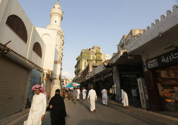 epa08813297 (FILE) - Saudis stroll a street of Balad which used to be the old city centre of Jeddah, Saudi Arabia, 21 September 2015 (reissued 11 November 2020). French Foreign Ministry officials on 11 November 2020 said four people were injured in an explosion of a device at a cemetery during a Remembrance service in Jeddah. The wounded were part of a number of European diplomats that took part in the ceremony which was held at a non-Muslim cemetery, the French Foreign Ministry offiials said.  EPA/AMEL PAIN *** Local Caption *** 52232003
