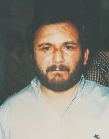 La foto segnaletica di Giovanni Brusca diffusa nel maggio del '96.    MIKE PALAZZOTTO/ANSA