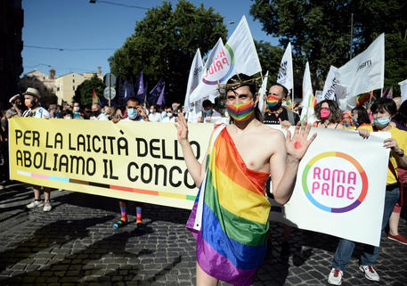 Members and supporters of the lesbian, gay, bisexual and transgender (LGBT) community take part in the Rome Pride parade in Rome, Italy, 26 June 2021. ANSA/FABIO CIMAGLIA
