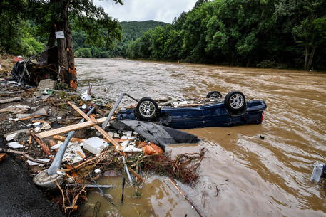 epa09345918 A destroyed car lies in the Ahr river after heavy flooding in Schuld, Germany, 15 July 2021. Large parts of Western Germany were hit by heavy, continuous rain in the night to 15 July resulting in local flash floods that destroyed buildings and swept away cars.  EPA/SASCHA STEINBACH