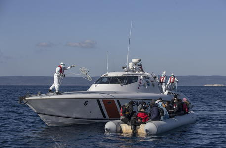 epa09131056 Members of the Turkish Coast Guard take migrants, who were allegedly pushed back from the Greece side, on a boat during a patrol to search and rescue for migrants offshore the Ayvalik district in Balikesir, Turkey, 10 April 2021 (issued 12 April 2012). The Greek island of Lesbos hosts one of the hotspots, an initial reception centers for migrants in European Union. Turkish authorities told epa/Efe that in 2020 around 45 percent of migrants rescued in the Aegean Sea had been pushed back from Greek territory. Most common cases involve migrant vessels being stopped by a Greek patrol when entering Greek waters, but the Turkish coastguard says it has heard lots of migrants describing 'delayed pushback,' when people are returned to the sea days after they reached Lesbos. According to Turkish officials, in this case, a Greek patrol carries the detained migrants to the limit of Greek territorial waters before putting them in a life raft and alerting Ankara.  Since the beginning of 2021, Turkey has rescued around 2,700 migrants in the Aegean Sea, and some 1,900 migrants from a pushback.  The Norwegian NGO Aegean Boat Report claims, some 558 people have been abandoned on 35 life rafts at sea so far in 2021. Some such incidents have ended with fatalities, the organizations claimed.  EPA/ERDEM SAHIN  ATTENTION: This Image is part of a PHOTO SET